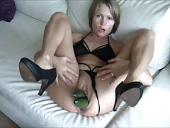 Worthless dumb German blonde cunt with cucumber in pussy and ass