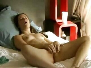 Cute brunette fingers her pussy to orgasm