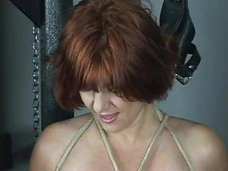 Nude redhead with nice ass is bdsm dungeon...