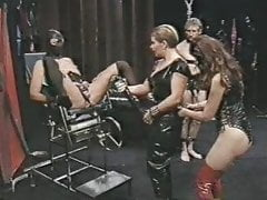 Woman fucks male slave with big strapon