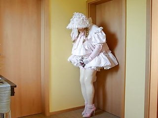 Sissy in frilly pink  little girl style dress.