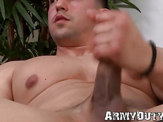 Muscle army man tugging cock...