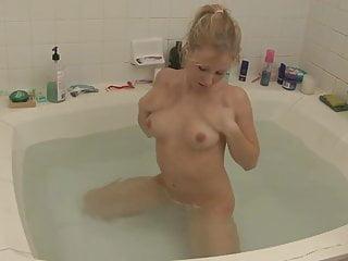 Sexy butt takes a sensual bath...