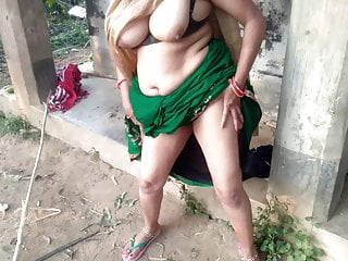 Desi Indian MILF with a big ass milks her own boobs in a farmhouse
