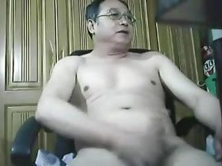 Chinese daddy jerks off on webcam