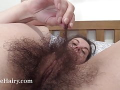 Effy shows off her very hairy pussy in bed