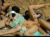 Arab woman in the desert having sex with a group of men
