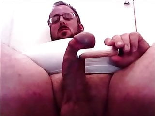 Chubby UK bear Bareboots plays with his big erect penis