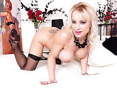 Busty blonde Milf wanks off in sheer pantyhose and stilettos