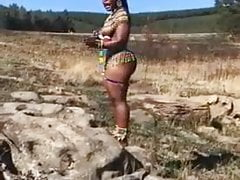 African girl talks majestically with her huge butt out