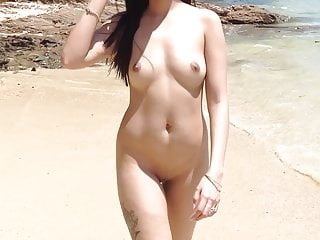 Naked Asian girl on the beach