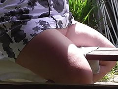 Pantieless wife playing with pussy on the bench V00