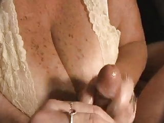 Handjob with cum on huge cleavage