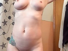 blonde with big boobs is getting naked to take a showerPorn Videos