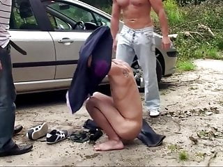 Cuffed boy gets face fucked outdoors