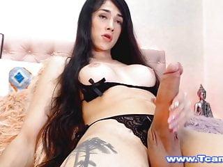 Shemale seductively masturbates her cock...
