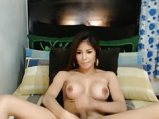 Beautiful busty babe faps cock...