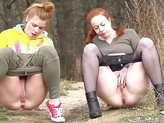 Girls peeing together