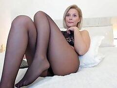 Blonde model wearing black stockings