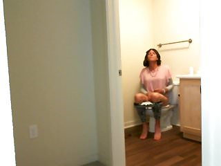 Tranny gurls sit down to pee wipes her...