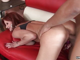Red haired cougar, Crystal White eagerly sucks a black cock