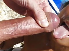 beach slut takes a big cumshot