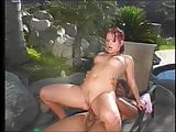Black man gets his cock sucked and ass fucks sexy redhead poolside