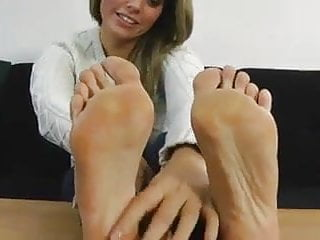 izzy shows her bare foot