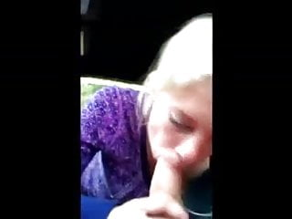 Blonde girl sucks in car