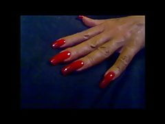 sexy elegant hands with super sexy long red nails fingernail