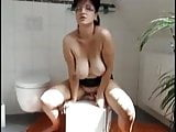 takes out her big mature tits while sitting on thick dildo