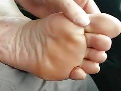 Under her feet rubbing her feet