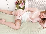 Cheeky blonde takes off retro lingerie fucks glass dildo toy