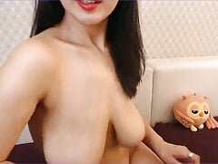Naked Chinese woman with big boobs