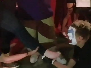 Clown Having Some Feet On His Face