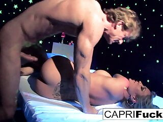 Black-light painted hottie gets a good fucking