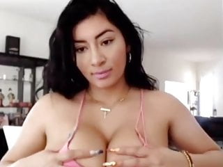 I need the name of this busty Asian webcam hottie.